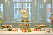 wedding cake table with semi-naked drip cake and cupcakes
