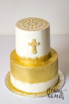 golden and white baptism cake