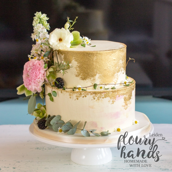 vintage gold rustic wedding cake with real flowers