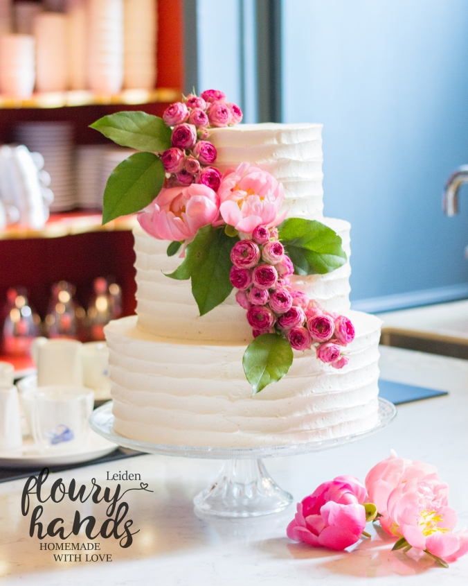 rustic vintage beautiful white wedding cake with flowers