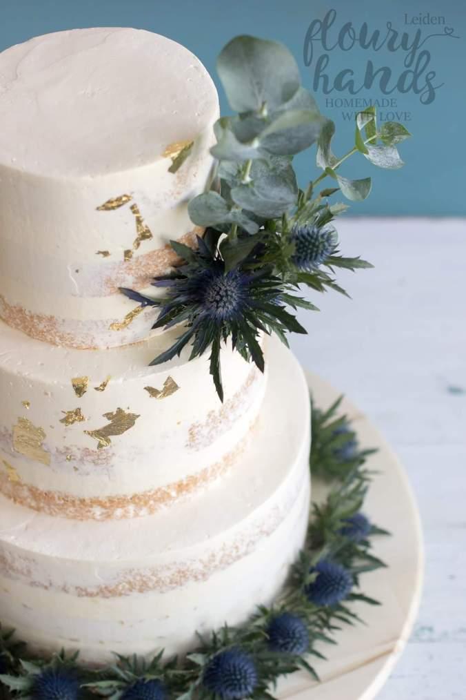 semi-naked wedding cake with thistel and eucalyptus