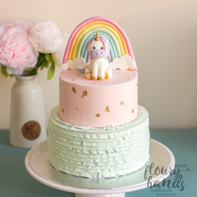 Girl birthday cake with unicorn and rainbow